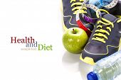 Different tools for sport and healthy food for diet on white background - sport, health and diet con