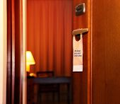 Please Do Not Disturb Sign Hanging On Open Door