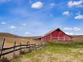 Red Barn And Blue Sky.