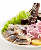 Herring Served with Potato, Onions and Bried Sticks