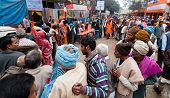 Hindu Devotees Qued Up For Food At Transit Camp