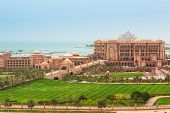 ABU DHABI, UAE - MARCH 25: Emirates Palace and gardens on March 25, 2014, UAE. Five stars Emirates Palace is the second most expensive hotel ever built for  about 6 billion USD.