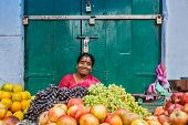 TIRUCHIRAPALLI, INDIA - FEBRUARY 14, 2013: Unidentified Indian woman - hawker (street vendor) of fruits