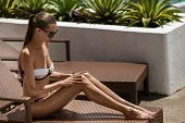 Young woman sunbathing. Resort and Spa.