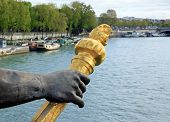 Arm of nymph and torch, bridge Alexandre III  Paris France
