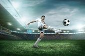 picture of playground  - Soccer player with ball in action outdoors - JPG