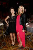 NEW YORK-APR 9: Figure skater Sasha Cohen and gymnast Nastia Liukin (R) attend the Food Bank for New