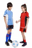 Girl And Boy Soccer Players Giving A Coin To Choose