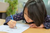 Cute Little Girl Is Drawing Cartoon