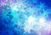 Conceptual image with snowflakes on blue background