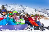 Group of young people with snowboards and goggles