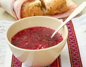 Traditional Ukrainian beetroot soup - red borsch and dumplings