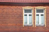 white window on red wooden wall