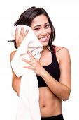 stock photo of transpiration  - Fitness woman wiping sweat with a towel - JPG