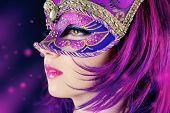 stock photo of masquerade  - Beautiful young woman in carnival mask - JPG