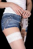 Girl Holds A Guitar Between His Legs