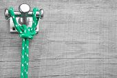 Maritime wooden background - scenery with green rope