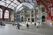 ANTWERP, BELGIUM - JUNE 23, 2013: People in the Central train station. Since 2007, 3 more levels for high-speed trains opened under the usual station