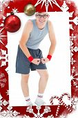 Geeky hipster posing in sportswear against christmas themed page