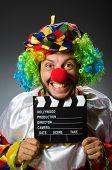 Clown with movie clapper board