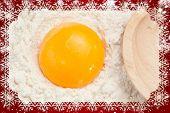 SnowComposite image of snow flakes against egg yolk on the flour