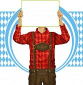 Idea concept. Man with write board in lederhosen on oktoberfest