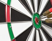 stock photo of projectile  - darts arrows in the target center - JPG