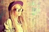 pic of dreadlocks  - Modern teenage girl with blonde dreadlocks over grunge background - JPG