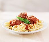 spaghetti and meatballs on empty table