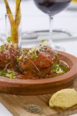 Meat Balls Served With Sauce On Hot Ceramic Plate With Condiment