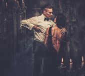 Woman with violin body art and man holding bow