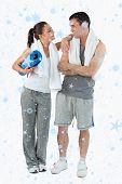 Composite image of Portrait of a happy couple going to practice yoga with snow falling