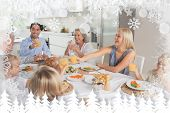 Family raising their glasses together against fir tree forest and snowflakes