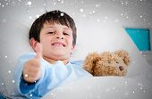 Composite image of little boy hugging a teddy bear lying in a hospital bed against snow