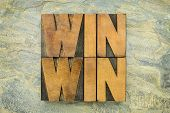 win-win - negotiation or conflict resolution strategy  -  words in letterpress wood type against slate rock background