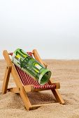 a deck chair with a euro banknote. symbol photo for saving on holiday and when traveling