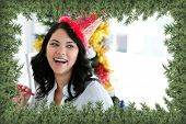Composite image of positive businesswoman celebrating christmas against green fir branches