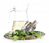 A big pitcher of fresh birch sap isolated on white