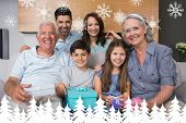 Extended family on sofa with gift boxes in living room against fir tree forest and snowflakes