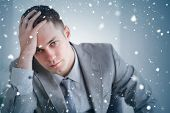 Composite image of close up of businessman who got bad news against snow falling