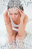 Cute woman having a headache against snowflakes on silver