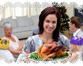 stock photo of turkey dinner  - Woman showing Christmas turkey for family dinner against snowflake frame - JPG