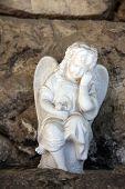 ZAGREB, CROATIA - APRIL 29: A white mourning porcelain angel at Mirogoj cemetery in Zagreb, Croatia