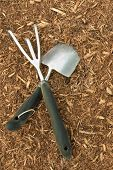 Closeup of Garden Tools on Bark Mulch