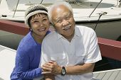 Asian Senior couple embracing in Marina (portrait)