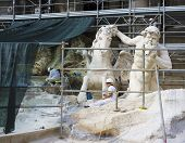 ROME, ITALY - SEPTEMBER 22, 2014: Famous Trevi Fountain (Fontana di Trevi) under restoration.