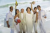 picture of extended family  - Multi Ethnic Family celebrating wedding on beach - JPG