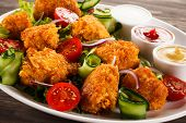 Grilled chicken nuggets and vegetables