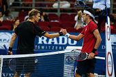 SEPTEMBER 25, 2014 - KUALA LUMPUR, MALAYSIA: Leonardo Mayer congratulates Jarkko Nieminen for his win in their match at the Malaysian Open Tennis 2014. This is an ATP sanctioned tournament.