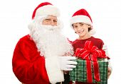 Santa giving a Christmas gift to a cute little boy.  Isolated on white.